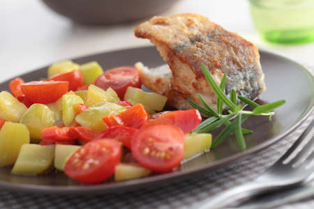 Roasted cod with summer squash, cherry tomato, and rosemary photo