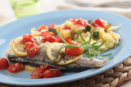 Baked sea bass with vegetables and rosemary photo