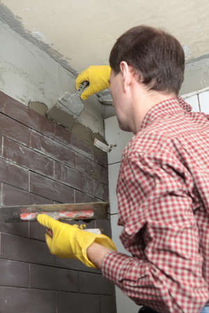 Contractor installing tiles on a wall Stock Photo - 14334440