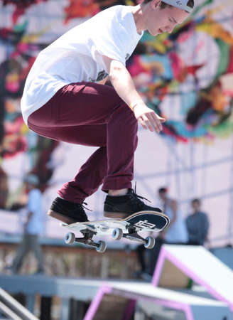 adrenalin: MOSCOW, RUSSIA - JULY 8: Sergey Glushchenko in skateboarding competition during Adrenalin Games in Moscow, Russia at July 8, 2012 Editorial