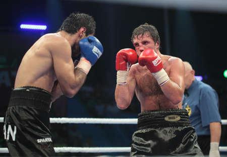 igor: ODESSA, UKRAINE - JULY 21: Fight Valeriy Brazhnyk (right) vs Igor Fanian in Odessa, Ukraine at July 21, 2012 Editorial
