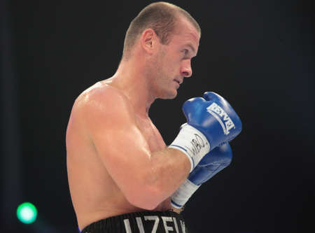 the heavyweight: ODESSA, UKRAINE - JULY 21: Vyacheslav Uzelkov (pictured) vs Mohamed Belkacem in fight for WBO Inter-Continental light heavyweight title in Odessa, Ukraine at July 21, 2012