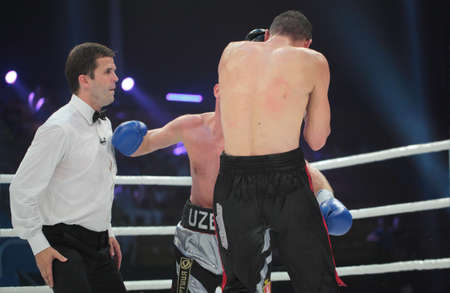 the heavyweight: ODESSA, UKRAINE - JULY 21: Vyacheslav Uzelkov (in blue gloves) vs Mohamed Belkacem in fight for WBO Inter-Continental light heavyweight title in Odessa, Ukraine at July 21, 2012