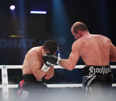 the heavyweight: ODESSA, UKRAINE - JULY 21: Vyacheslav Uzelkov (right) vs Mohamed Belkacem in fight for WBO Inter-Continental light heavyweight title in Odessa, Ukraine at July 21, 2012
