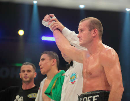 the heavyweight: ODESSA, UKRAINE - JULY 21: Vyacheslav Uzelkov wins the match with Mohamed Belkacem for WBO Inter-Continental light heavyweight title in Odessa, Ukraine at July 21, 2012