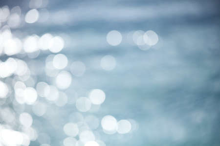 Defocused light reflection on a water surface photo