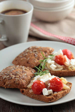 Sandwiches with rye bread, feta cheese, and roasted vegetables photo