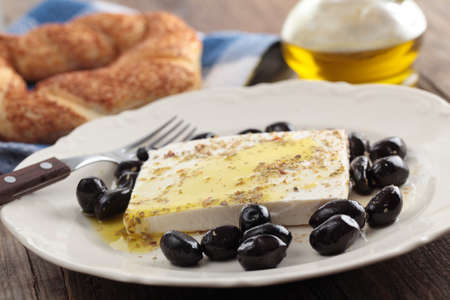 feta: Breakfast with feta cheese, olives, simit, olive oil and spices Stock Photo