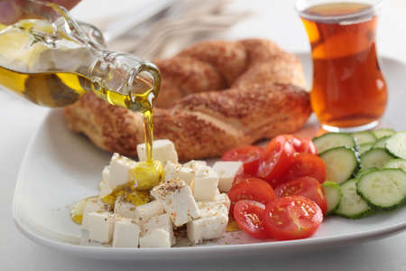 Breakfast with feta cheese, simit, vegetables and tea