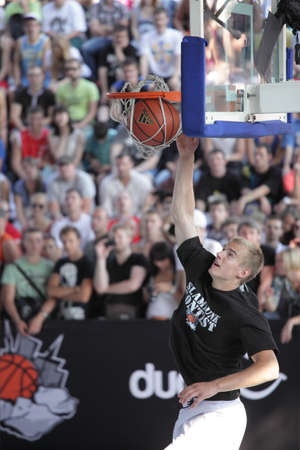 MOSCOW, RUSSIA - JULY 28: Latvian Kristaps Dargais take the second place in slam dunk contest during International Street Basketball Cup 'Moscow Open' in Moscow, Russia at July 28, 2012