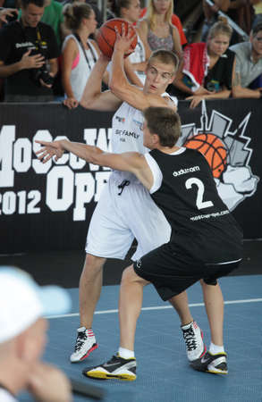 international basketball: MOSCOW, RUSSIA - JULY 28  Match  Bwin com , Slovenia vs  Ghetto Family , Latvia during International Street Basketball Cup  Moscow Open  in Moscow, Russia at July 28, 2012