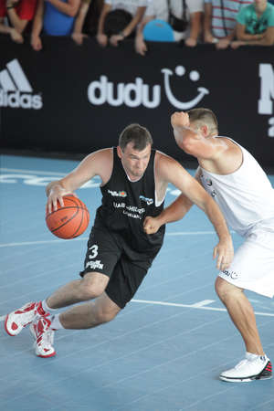 international basketball: MOSCOW, RUSSIA - JULY 28  Match UAB  Hidras , Lithania vs  Ghetto Family , Latvia during International Street Basketball Cup  Moscow Open  in Moscow, Russia at July 28, 2012