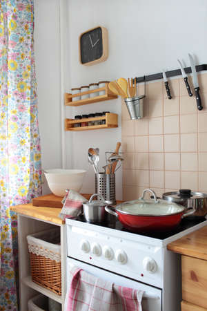 tiled stove: Domestic kitchen interior with stove Stock Photo