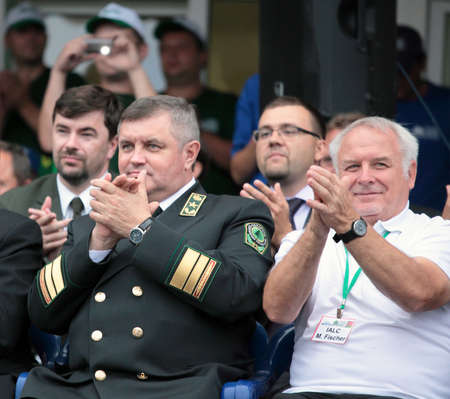 mikhail: Raubichi, Minsk region, Belarus - August 24, 2012: Minister of forestry of republic of Belarus Mikhail Amelyanovich (left) and the President IALC Max Fischer on the opening ceremony during World Logging Championship in Raubichi, Minsk region, Belarus at A