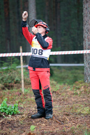 tree felling: Raubichi, Minsk region, Belarus - August 25, 2012: Richard Elliott from United Kingdom before tree felling during World Logging Championship in Raubichi, Minsk region, Belarus at August 25, 2012