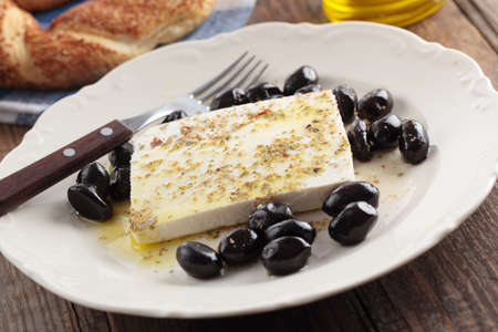 Breakfast with feta cheese, olives, simit, olive oil and spices photo