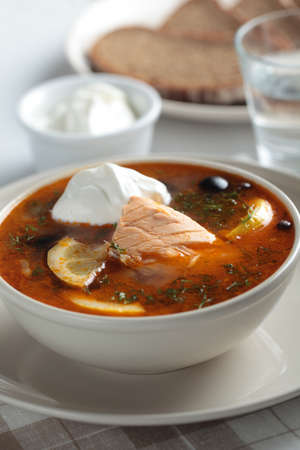 solyanka: Solyanka, Russian soup with salmon, olives and sour cream