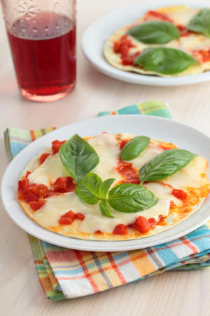 Tortilla pizza with mozzarella cheese, pepper, and basil photo