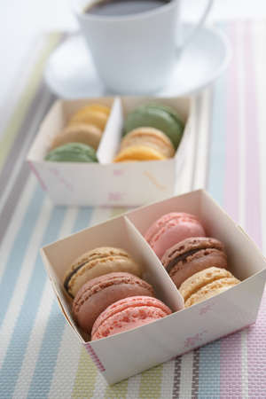 Macarons in a paper box and a cup of coffee Stock Photo - 15687986