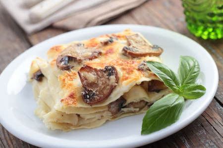 Lasagna with mushrooms and basil leaf