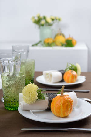 Thanksgiving table setting with decorative pumpkins photo