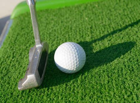 Minigolf ball on a course before a stroke photo