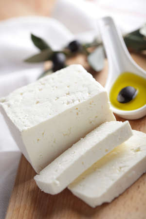 sliced cheese: Feta cheese and black olive in olive oil Stock Photo