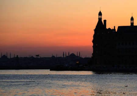 Sunset over the Bosporus passage in Istanbul, Turkey photo