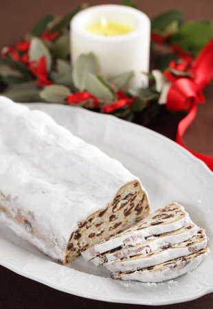 Stollen and Christmas wreath on a table photo