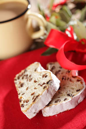 Two slices of Christmas Stollen on a table photo