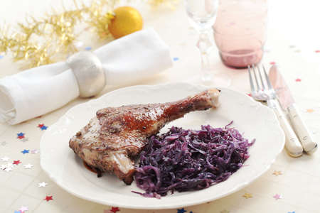 Goose leg and braised red cabbage on a Christmas table photo