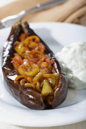 Turkish dish Imam bayildi with cacik photo