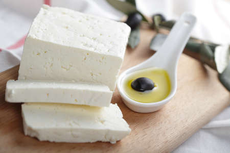 Feta cheese and black olive in olive oil photo