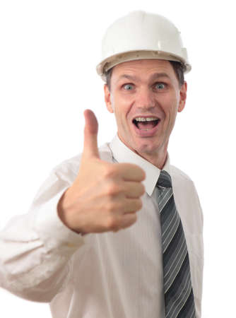Engineer in a hardhat giving thumbs up sign against white background photo