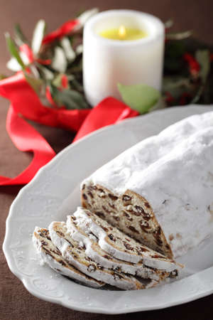 Stollen and Christmas wreath on a table Stock Photo - 16333178