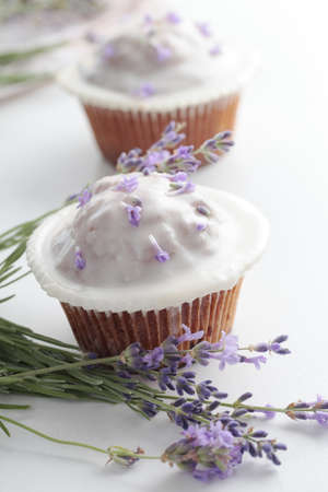 lavender flowers: Cupcakes with frosting and a bunch of lavender