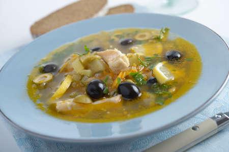 solyanka: Solyanka with salmon and olives closeup Stock Photo