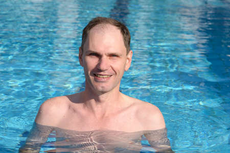 exersice: Happy man in a swimming pool