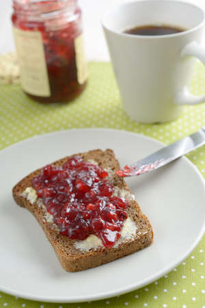 Sandwich with butter and lingonberry jam photo