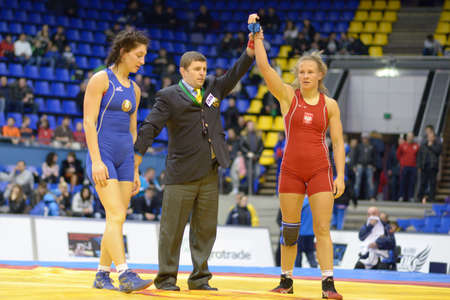 female wrestling: Kiev, Ukraine - February 16, 2013  Agnieszka Wieszczek-Kordus, Poland win the match with Vasilisa Marzaliuk, Belarus during XIX International freestyle wrestling and female wrestling tournament in Kiev, Ukraine on February 16, 2013