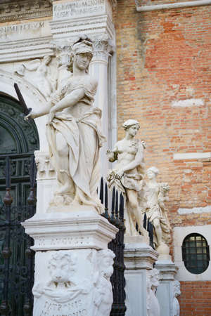 arsenal: Classical sculptures near the main gate of Venetian Arsenal Stock Photo