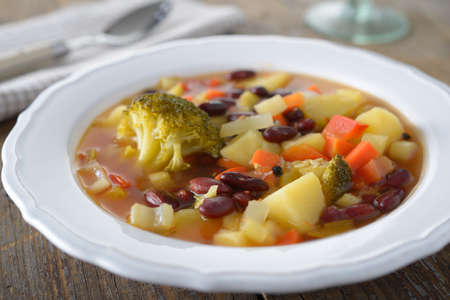 Minestrone with potato, red beans, carrot, broccoli, and celery photo
