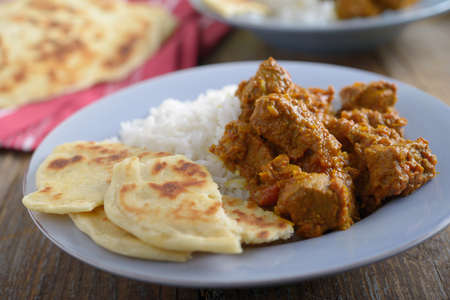 Beef curry with rice and naans photo
