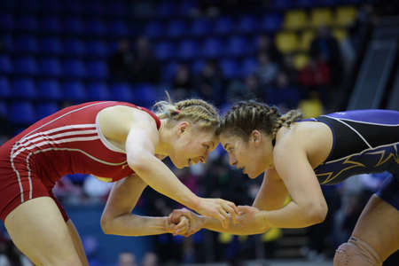 female wrestling: Kiev, Ukraine - February 16, 2013: Match between Helen Maroulis, USA, blue and Katsiaryna Hanchar, Belarus during XIX International freestyle wrestling and female wrestling tournament in Kiev, Ukraine on February 16, 2013 Editorial