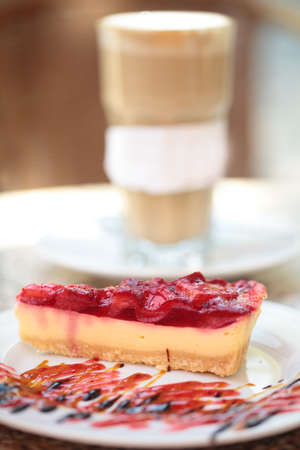 Cheesecake with strawberry and coffee latte photo