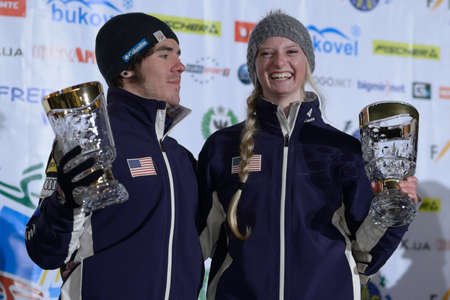 Bukovel, Ukraine - February 23, 2013: Kiley McKinnon, USA (right) and Michael Rossi, USA got awards during Freestyle Ski in Bukovel, Ukraine on February 23, 2013.