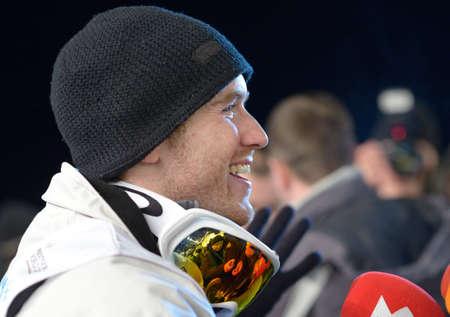 morris: Bukovel, Ukraine - February 23, 2013: Winner David Morris, Australia gives interview during Freestyle Ski World Cup in Bukovel, Ukraine on February 23, 2013.