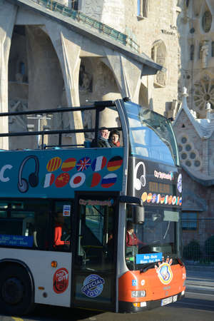 Barcelona, Spain - January 9, 2013  Tourists in a sightseeing tour bus against Sagrada Familia in Barcelona, Spain on January 9, 2013  The number of tourists visiting Barcelona increase steadily during last 3 years Stock Photo - 18584765