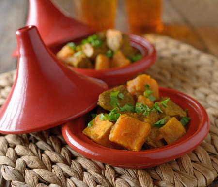Tajine with chicken meat and sweet potato photo