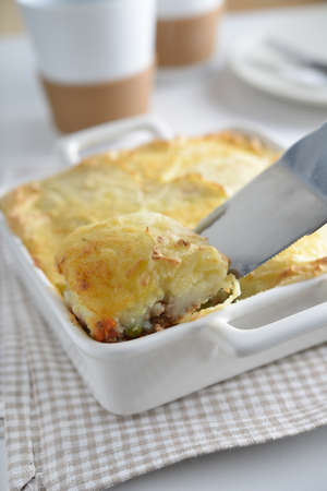 Cottage pie in a baking dish photo